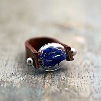 NEW: Genuine leather ring with real cornflowers. Brown leather; glass lense filled with blue cornflowers. Adjustable. Modern nature jewelry.
