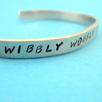 Doctor Who Inspired Bracelet - Wibbly Wobbly Timey Wimey - Hand Stamped Aluminum Cuff - customizable