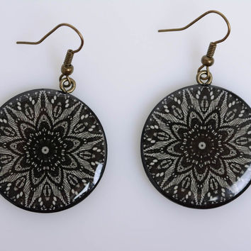 Handmade round ornamented dark polymer clay dangling earrings with decoupage