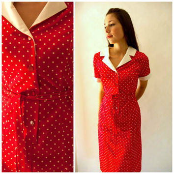 1960's red and white polka dot diner dress with white collar and waist tie.  Size