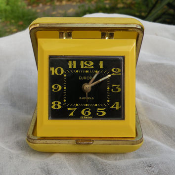 Yellow alarm clock. German alarm clock. Europa clock. Retro clock. Vintage clock. Yellow clock. Travel clock. Night stand clock. Clock