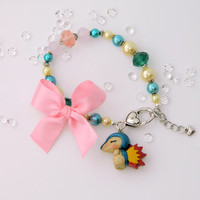 Cyndaquil Pokemon bracelet with handmade polymer clay charm in pink and teal