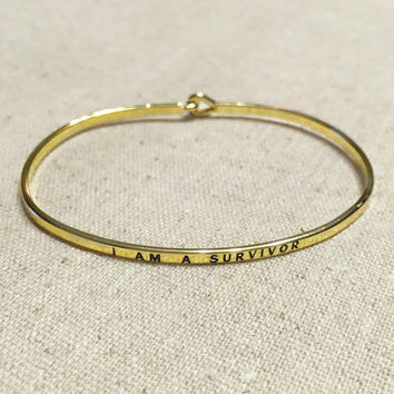 Exclusive: Survivor Bangle