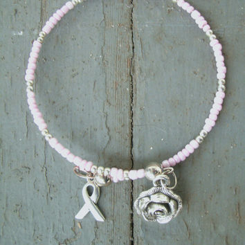 Pink Cancer Ribbon and Rose Bracelet - light pink seed beads, memory wire, rose charm and ribbon charm in silver tone, cancer awareness