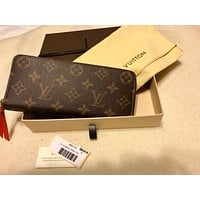 LOUIS VUITTON Monogram Portefeiulle Clemence zip around wallet Orange M60743