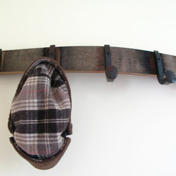 Wine barrel stave coat rack with repurposed railroad spike hooks