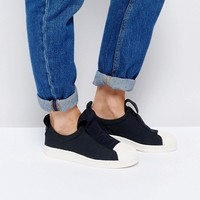 adidas Originals Black Superstar Slip On Sneakers With Bold Strap at asos.com