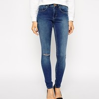 ASOS Mid Rise Skinny Jeans in Mount Eden Mid Wash Blue with Ripped Kne