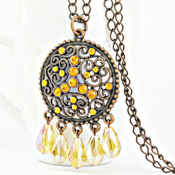 Copper and glass big pendant with rhinestone and drop beads in topaz