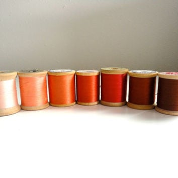 Vintage sewing thread lot of 7 wooden spools in fall colors orange, peach, gold and red