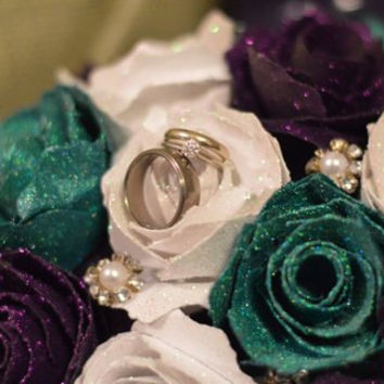 Purple and Teal Wedding Bouquet with train of flowers.  features over 40 blooms of glittered Roses