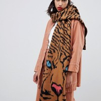 ASOS DESIGN tiger face knitted scarf at asos.com