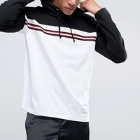 ASOS Oversized Long Sleeve Hooded T-Shirt With Contrast Taping at asos.com