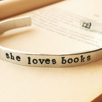 she loves books, one aluminum  1/4 inch wide bracelet