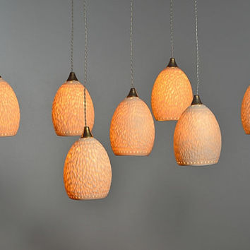 7 egg shaped light fixture made of curved and pierced porcelain. Pendant light, ceiling lamp.