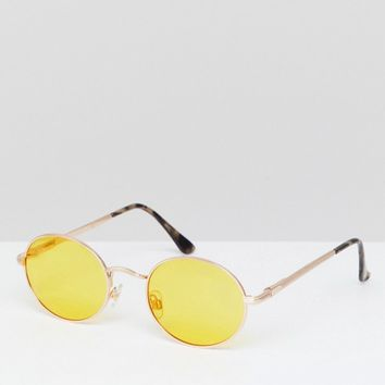 River Island Oval Yellow Tinted Lense Sunglasses at asos.com