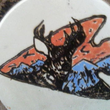 Hand crafted painted Deer in Arrowhead Round Plaque with Mountain Scenery.