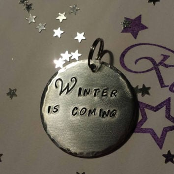 Winter is coming hand stamped aluminium keyring saying quote