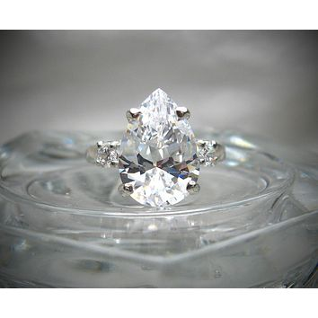 A Handmade 4CT Pear Cut Russian Lab Diamond Engagement Ring