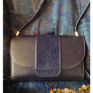 Vintage Christian Dior black suede and smooth leather shoulder clutch bag with logo embossed on flap.