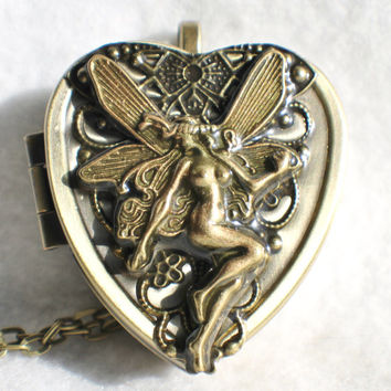 Music box locket,  heart shaped locket with music box inside, in bronze with fairy and bronze filigree.