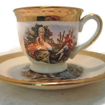 Homer Laughlin Eggshell Georgian Thick 22Kt Gold Trim and Victorian People Design Teacup and Saucer