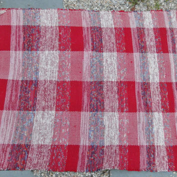 Red and white primitive hand woven rag rug