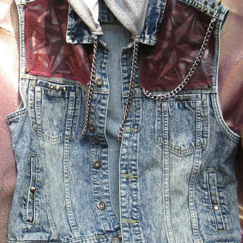 Denim hoodie vest embellished with chains, painted symbols, spikes and studs. Young mans size extra large.