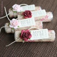floral wedding favors with burgundy and pale pink roses