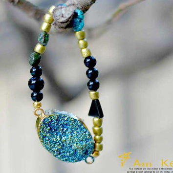 Let Aqua Fairy Dust Druzy bring a little magic in your life, here it is paired with Turquoise Obsidian and Taiwanese Wood Golden Beads