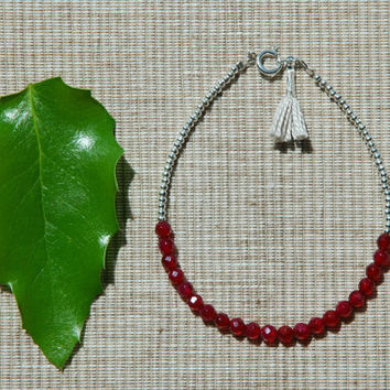 Goddess. Sterling silver bracelet with maroon indian glass beads and small tassel.