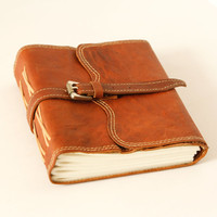 Buckled secure leather notebook journal Coptic Stitched and hand bound with cotton recycled paper
