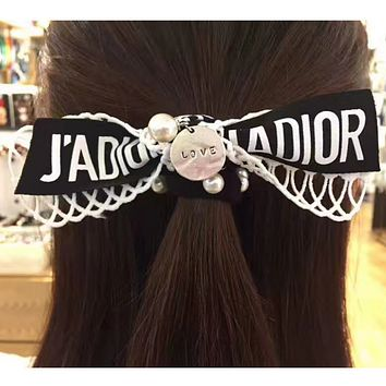Dior pearl drop letters knot hair exaggerated hollow double bowknot