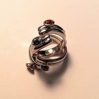 Modern sterling silver wrap around ring, with honey and blue tone stone accents, high polished original design