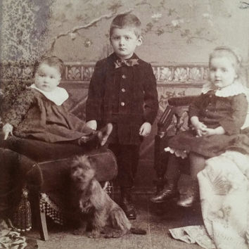 Victorian cabinet card of children with their pet dog jack russell from columbus Ohio
