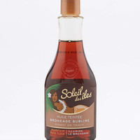 Soleil des iles Bronzage Sublime Tinted Shimmering Body Oil - Urban Outfitters