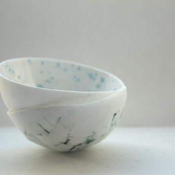 Decorative stoneware fine bone china bowl with a unique texture of broken pieces and cracks and glossy interior with blue speckles