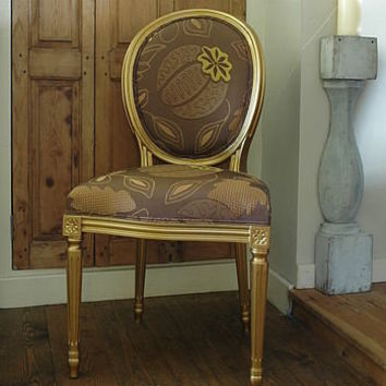 vintage reupholstered chocolate and gold chair by ghost furniture | notonthehighstreet.com