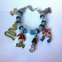 Christmas charm bracelet, Christmas jewelry, santa hat, angel, christmas tree, silver bells, by BeadingByJenn on etsy