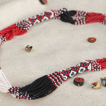 Massive handmade beaded necklace with beautiful patterns in ethnic style