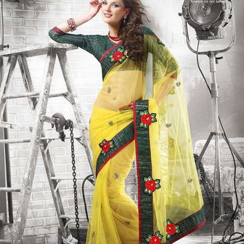 Ftrendy yellow Embroidered Velvet, net, sattin Saree