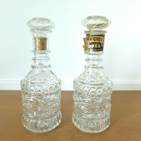 Two 1960s clear glass liquor decanters, vintage Jim Beam and Dark Eyes bottles