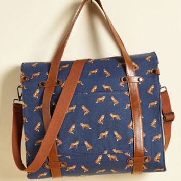 Camp Director Snapped Tote in Foxes