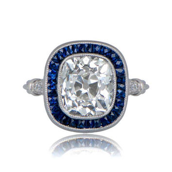 Diamond and Sapphire Engagement Ring. Featuring a 3.48ct Antique Cushion Cut Diamond.