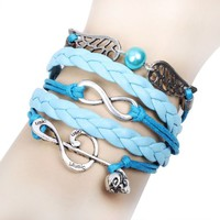 Silver Skull Music and Forever Wing Charms on a Handmade Blue Infinity Bracelet