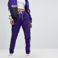 Ellesse Retro Tracksuit Bottoms With Contrast Panels And Logos at asos.com