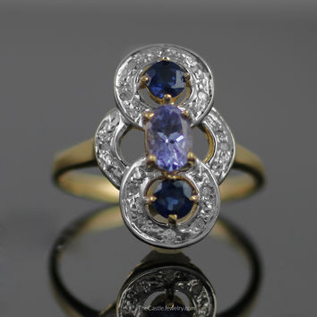 Unique Open Design Sapphire and Tanzanite Ring with Diamonds in 14K Gold
