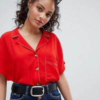 Bershka contrast stitch and pocket detail shirt in red at asos.com