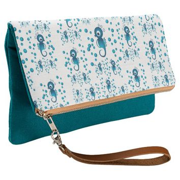 Seahorses pattern blue clutch