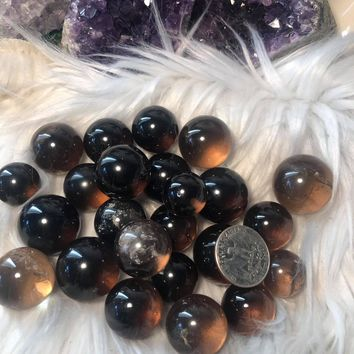 Smoky quartz pocket spheres